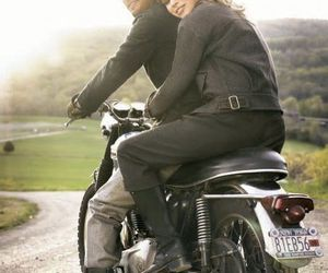 couple and motorcycle image