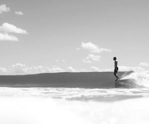black and white, ocean, and surfing image
