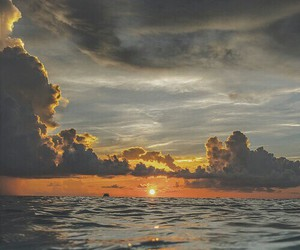 sea, sunset, and clouds image