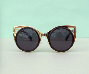 black, gold, and sunglasses image
