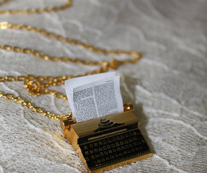 book, necklace, and gold image