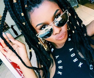 braids, glasses, and gold image