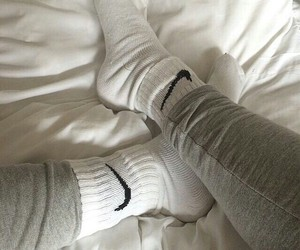 bed, cozy, and leggings image