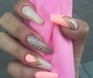 sparkles and coral nails image