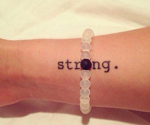 strong and tattoo image