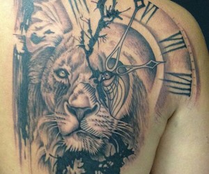 tattoo, lion, and clock image