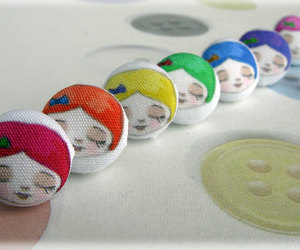 buttons, doll face, and earrings image