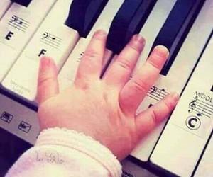 baby, hand, and piano image
