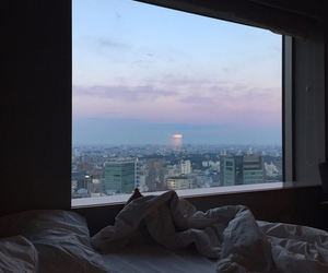 city, bed, and sky image