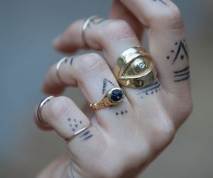 tattoo, rings, and hand image
