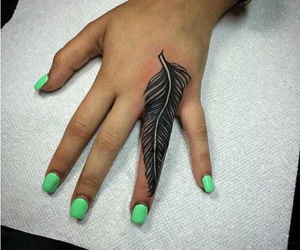 tattoo, feather, and hand image
