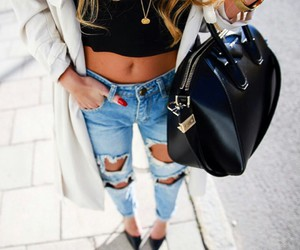 red nails, gold necklaces, and black pumps image