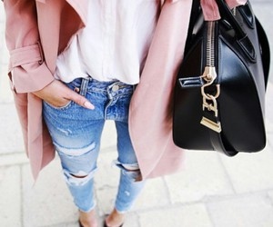black purse, white blouse, and gold necklaces image