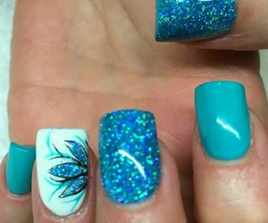 turquoise nail polish and blue colored sparkles image