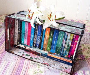 bed, books, and flowers image
