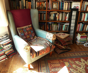 book, chair, and library image