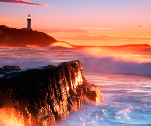 sea, beach, and lighthouse image