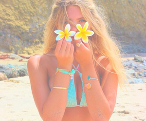 girl, beach, and flowers image