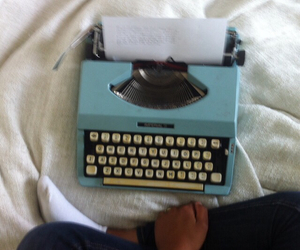 bed, type writer, and writing image