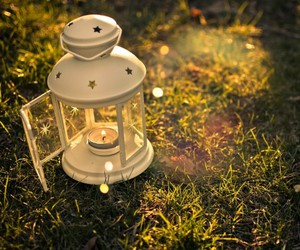 candle, grass, and lamp image