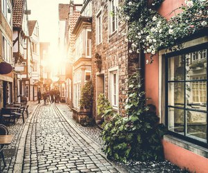 street, sun, and town image