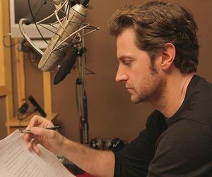 actor, microphone, and reading image