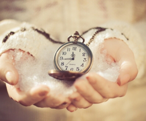 clock, hands, and snow image