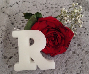 candle, flowers, and letters image