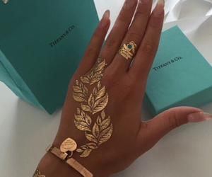 gold, nails, and tattoo image