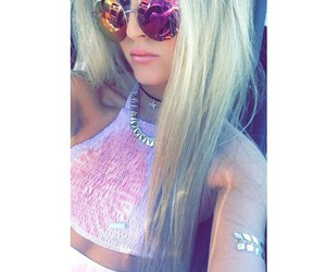 circle sunglasses, straight blonde hair, and silver necklaces image