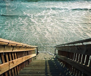 sea, beach, and stairs image