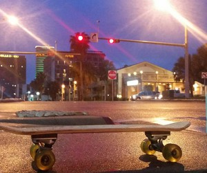 downtown, night, and skateboard image
