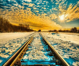 snow, sun, and sky image