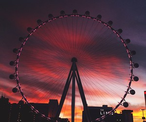 sunset, sky, and ferris wheel image