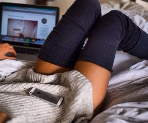 iphone, sweater, and bed image