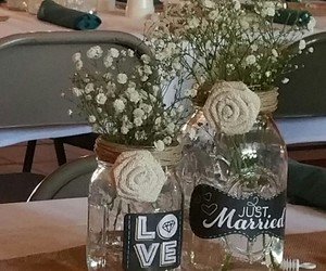 baby's breath, candles, and centerpieces image