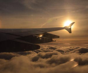 airplane, breathtaking, and clouds image