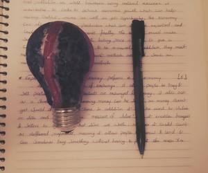 bulb, notebook, and pen image