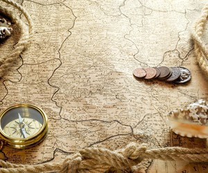 compass, map, and coins image
