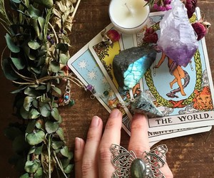 tarot, candle, and crystal image
