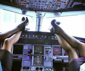 air, stewardess, and airplane image