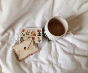 bed, cup of coffee, and Letter image