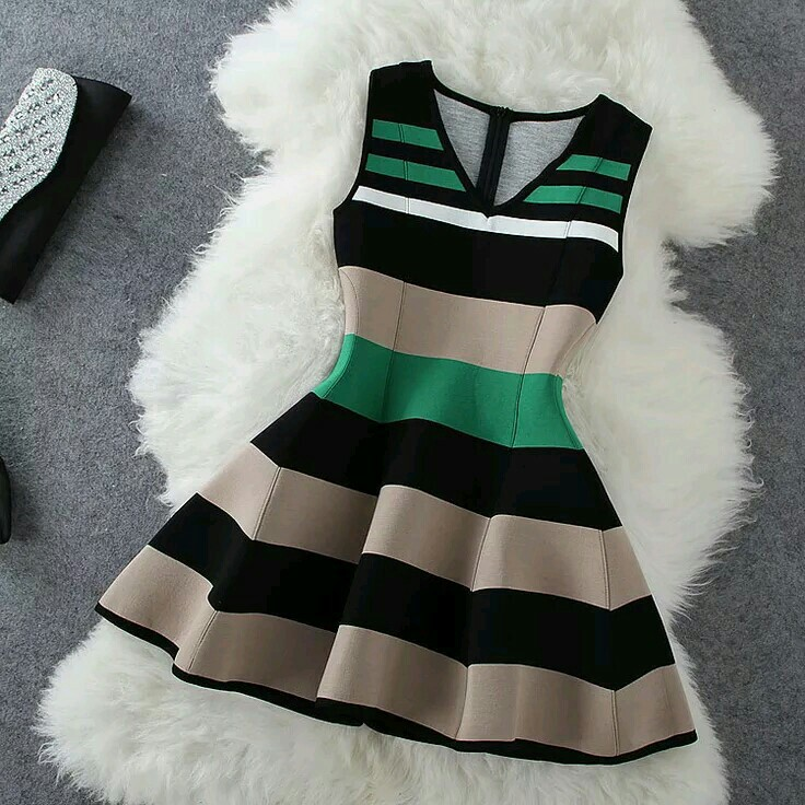 black, tan, and green and white image