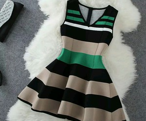 tan, green and white, and black image