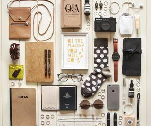 camera, essentials, and glasses image