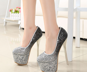 super high heels, silver pumps, and party show image