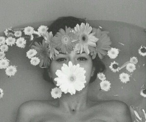 bathtub, black and white, and flowers image