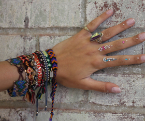 bracelet, rings, and hand image
