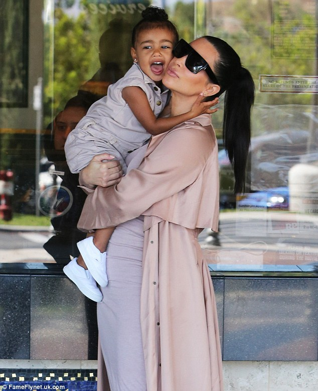 Kim Kardashian carries North West while going to the movies
