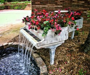 piano, flowers, and water image